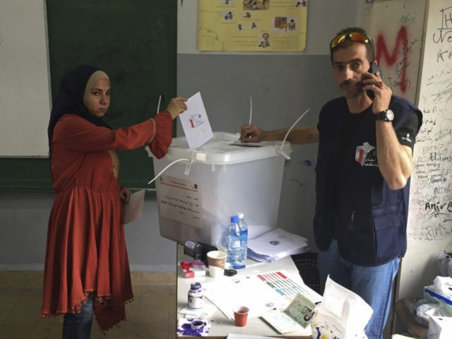Lebanon votes in shadow of Syria war, reflecting divisions