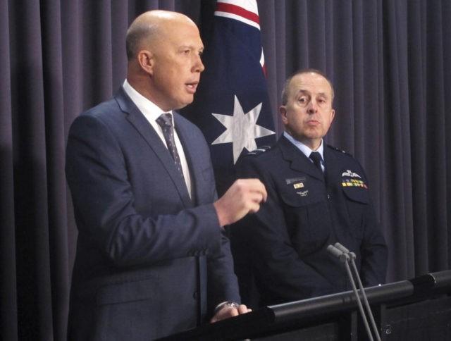 Australia says asylum seekers target New Zealand backdoor