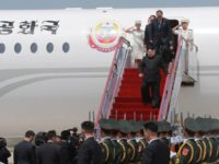 In this Monday, May 7, 2018, photo provided by the North Korean government, North Korean leader Kim Jong Un, center, arrives at an airport in Dalian, China. Unlike his dictator father, who famously shunned air travel, North Korean leader Kim Jong Un jetted off to the northeastern Chinese city of …