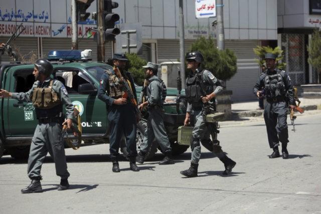 Suicide bombers strike in Afghan capital, killing 2 police