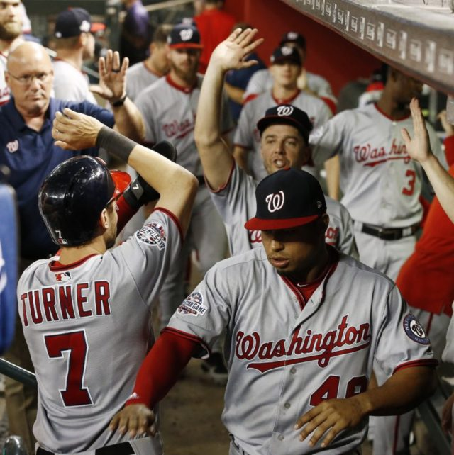 Adams' RBI single in 11th gives Nationals 2-1 win at Arizona
