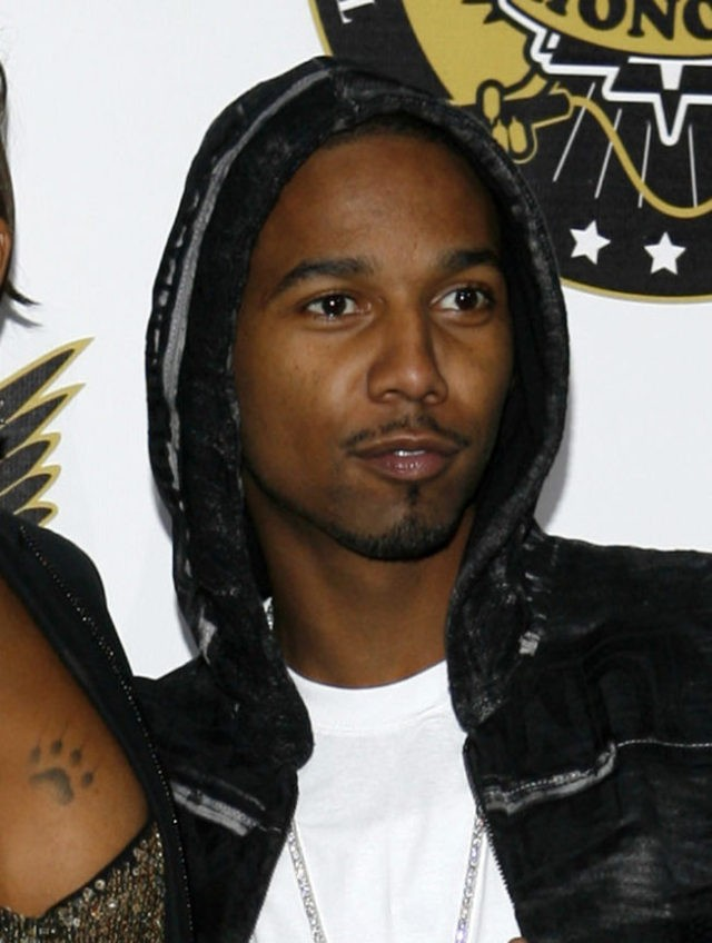 Rapper Juelz Santana pleads not guilty to airport gun charge