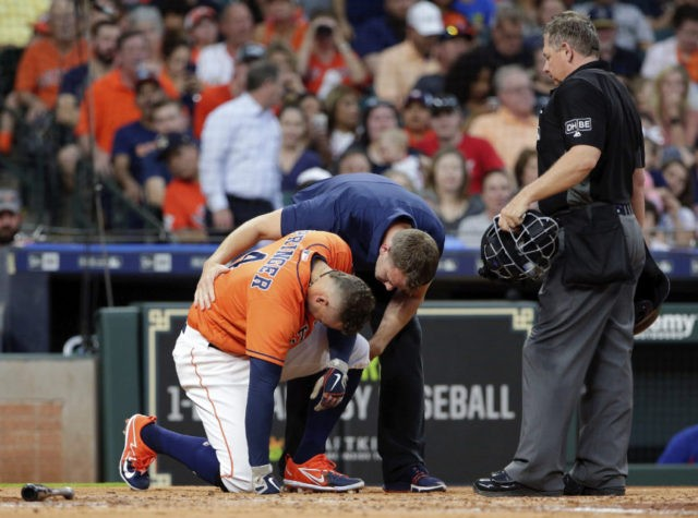 Astros' Springer day to day after taking pitch to left elbow