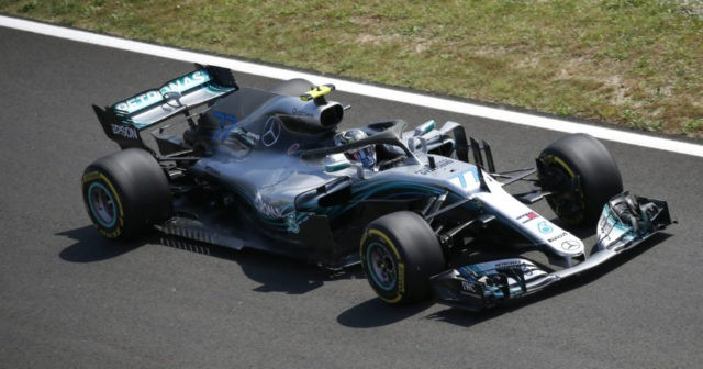 Mercedes sets the pace in 1st practice session in Spain