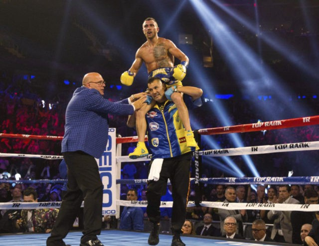 Lomachenko stops Linares in 10th, wins lightweight title