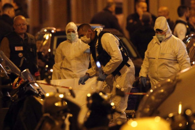 The Latest: Macron firm after Paris stabbing claimed by IS