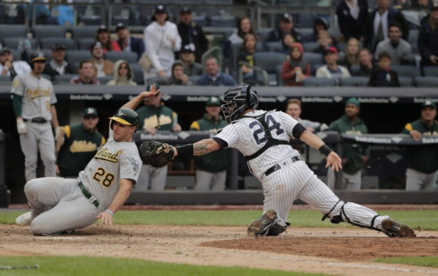 With help of reversal, Yanks top A's 7-6, stop tiny skid