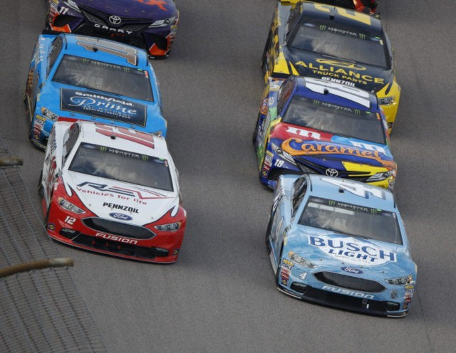 The Latest: Blaney wins Stage 1 at Kansas Speedway