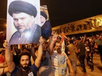 Followers of Shiite cleric Muqtada al-Sadr, seen in the posters, celebrate in Tahrir Square in Baghdad, Iraq, early Monday, May 14, 2018. Iraq's electoral commission announces influential Shiite cleric Muqtada al-Sadr is the current front-runner in national elections with official results in from just over half of the country's provinces. …