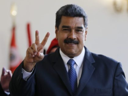 Venezuela's President Nicolas Maduro makes the victory sign after a meeting with former Spanish Prime Minister Jose Luis Rodriguez Zapatero at the presidential palace in Caracas, Venezuela, Friday, May 18, 2018. Maduro is seeking a new six-year mandate and, despite crippling hyperinflation and widespread shortages of food and medicine, he …