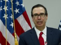 In this Saturday, April 21, 2018, file photo, Treasury Secretary Steve Mnuchin speaks during a news conference at World Bank/IMF Spring Meetings, in Washington. China's government says it cannot guarantee renewed trade tension with Washington can be avoided after U.S. Treasury Secretary Steven Mnuchin declared a temporary truce in a …