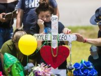 A young woman cries, Tuesday, May 22, 2018, by a memorial for Santa Fe High School freshman Aaron Kyle McLeod who was killed Friday during a shooting at the school, in Santa Fe, Texas. (Marie D. De Jesus/Houston Chronicle via AP)