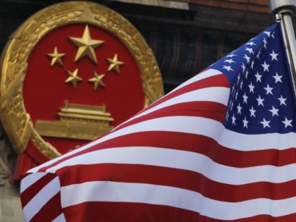 In this Nov. 9, 2017, file photo, an American flag is flown next to the Chinese national emblem during a welcome ceremony for visiting U.S. President Donald Trump outside the Great Hall of the People in Beijing. The State Department said an email notice Wednesday, May 23, 2018, that a …