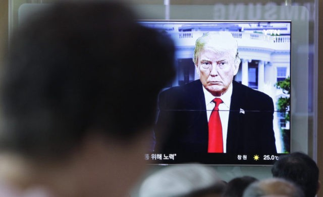 People watch a TV screen showing file footage of U.S. President Donald Trump during a news program at the Seoul Railway Station in Seoul, South Korea, Saturday, May 26, 2018. South Korea on Saturday expressed cautious relief about the revived talks for a summit between President Donald Trump and North …