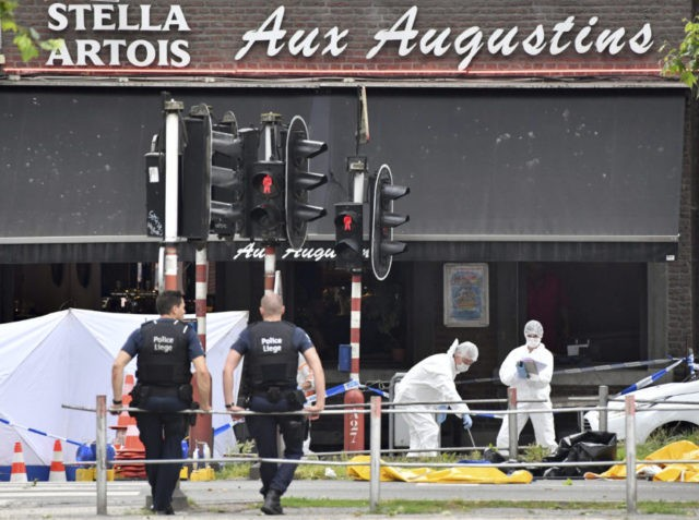 Forensic police, right, investigate at the scene of a shooting in Liege, Belgium, Tuesday, May 29, 2018. A gunman killed three people, including two police officers, in the Belgian city of Liege on Tuesday, a city official said. Police later killed the attacker, and other officers were wounded in the …