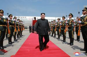 North Korea hails Kim achievements, warns U.S.