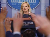 Journalist raise their hands to ask questions of Homeland Security Secretary Kirstjen during the daily briefing in the Brady Press Briefing Room of the White House, Monday, June 18, 2018. (AP Photo/Pablo Martinez Monsivais)