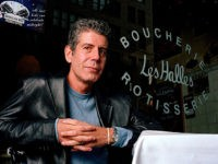 FILE-This dec. 19, 2001 file photo shows Anthony Bourdain the owner and chef of Les Halles restaurant sitting at one of its tables in New York. (AP Photo/Jim Cooper,File)