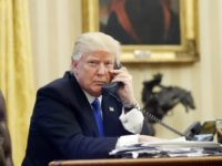 FILE - In this Jan. 28, 2017, file photo, U.S. President Donald Trump speaks on the phone with Prime Minister of Australia Malcolm Turnbull in the Oval Office of the White House in Washington. For decades, Australia and the U.S. have enjoyed the coziest of relationships, collaborating on everything from …