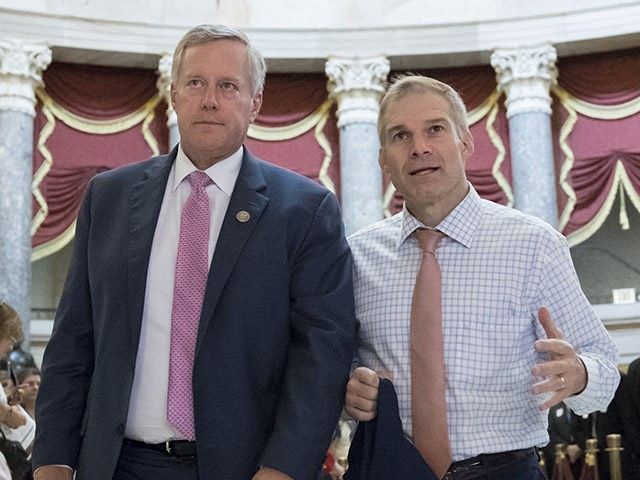 Rep. Mark Meadows, R-N.C., chairman of the conservative House Freedom Caucus, and Rep. Jim Jordan, R-Ohio, a key member of the group, walk through Statuary Hall at the Capitol in Washington, Wednesday, Sept. 13, 2017. With President Donald Trump wanting a legislative solution to replace the Deferred Action for Childhood …