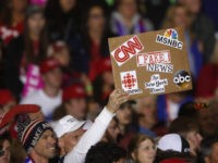 An audience member holds a fake news sign during a President Donald Trump campaign rally in Washington Township, Mich., Saturday, April 28, 2018. (AP Photo/Paul Sancya)