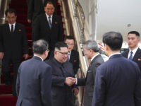 In this photo released by the Ministry of Communications and Information of Singapore, North Korean leader Kim Jong Un, center left, is greeted by Singapore Minister for Foreign Affairs Dr. Vivian Balakrishnan at the Changi International Airport, Sunday, June 10, 2018, in Singapore, ahead of a summit with U.S. President …