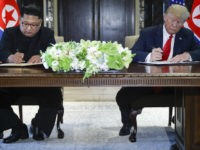 Donald Trump Signs Document with Kim Jong-un After Meeting