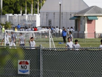 Immigrant children play outside a former Job Corps site that now houses them, Monday, June 18, 2018, in Homestead, Fla. It is not known if the children crossed the border as unaccompanied minors or were separated from family members. Wrenching scenes of migrant children being separated from their parents at …