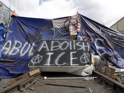 A barricade crosses railroad track at a protest camp on property outside the U.S. Immigration and Customs Enforcement office in Portland, Ore., Monday, June 25, 2018. Law enforcement officers began distributing notices to vacate to demonstrators late Monday morning. The round-the-clock demonstration outside the Portland headquarters began June 17, 2018, …