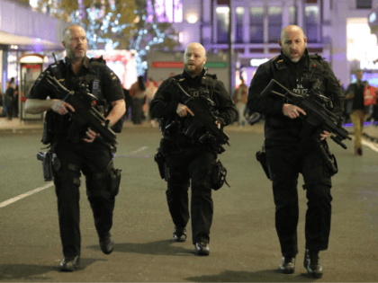 TOPSHOT - Armed police patrol near Oxford street as they respond to an incident in central London on November 24, 2017. British police said they were responding to an 'incident' at Oxford Circus in central London on Friday and have evacuated the Underground station, in an area thronged with people …