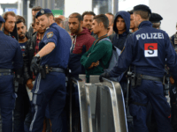 Police officers block refugees on a platform of the main train station in Salzburg, near the German-Austrian border, on September 16, 2015 as tens of thousands of migrants have entered Austria from Hungary in recent weeks. AFP PHOTO / CHRISTOF STACHE (Photo credit should read CHRISTOF STACHE/AFP/Getty Images)