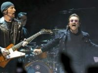 "Guitarist The Edge, left, and singer Bono, of the band U2, perform on stage during their ""eXPERIENCE + iNNOCENCE Tour"" at Capitol One Arena on Sunday, June, 17, 2018, in Washington. (Photo by Brent N. Clarke/Invision/AP)"