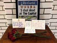 At the State House, letters and flowers form a memorial Friday, June 29, 2018, in Annapolis, Md., from Gov. Larry Hogan, state Senate President Thomas V. Mike Miller and House Speaker Michael Busch at the state house. The memorial is for the five dead members of the Capitol Gazette who …