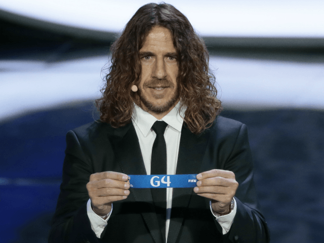 Former Spanish soccer international Carles Puyol holds a lot at the 2018 soccer World Cup draw in the Kremlin in Moscow, Friday, Dec. 1, 2017. (AP Photo/Ivan Sekretarev)