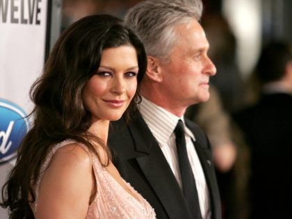 Actress Catherine Zeta-Jones (L) and actor Michael Douglas arrive at the Warner Bros. premiere of the film 'Ocean's Twelve' at Grauman's Chinese Theatre December 8, 2004 in Hollywood California. (Photo by Vince Bucci/Getty Images)
