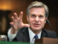 Christopher Wray Reaching