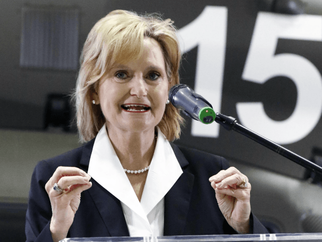 U.S. Sen. Cindy Hyde-Smith, R-Miss., speaks during a celebration of Airbus Helicopters, Inc., continuing relationship with the United States Army during a company celebration in Columbus, Miss., Friday, May 4 2018. Airbus Helicopters manufacturing facility recently received two new contracts to build a combined 51 UH-72A Lakotas for the United …