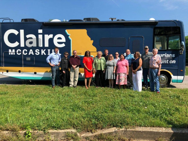 Missouri Sen. Claire McCaskill and group of people outside campaign RV.