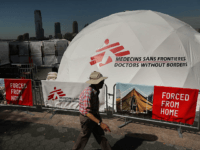 People walk by a traveling interactive exhibit organized by Doctors Without Borders (MSF) aimed to help people better understand the lives and challenges of some of the world's 65.3 million displaced individuals on September 23, 2016 in New York City.
