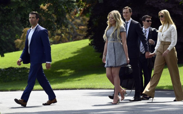 Donald Trump Jr., left, followed by Tiffany Trump, second from left, Jared Kushner, center, and Ivanka Trump, right, walk to Marine One on the South Lawn of the White House in Washington, Friday, June 1, 2018, as they head to Camp David for the weekend with President Donald Trump.
