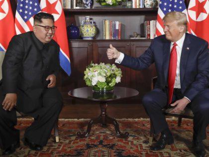 Donald Trump gives Kim Jong-un thumbs up (Evan Vucci / Associated Press)