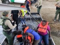 Eagle Pass Border Patrol agents rescue two adults and five minors from the Rio Grande River. (Photo: U.S. Border Patrol)