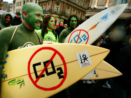 LONDON - DECEMBER 08: Climate change protestors carry surf boards near Trafalgar Square on December 8, 2007 in London. Demonstrators are gathering in more than 50 countries around the world. The worldwide protests coincide with the UN Climate talks in Bali and are calling for urgent action from world leaders …