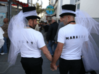 SAN FRANCISCO, CA - JUNE 26: Same-sex marriage supporters wear just married shirts while celebrating the U.S Supreme Court ruling regarding same-sex marriage on June 26, 2015 in San Francisco, California. The high court ruled that same-sex couples have the right to marry in all 50 states. (Photo by Justin …