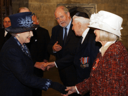 Britain's Queen Elizabeth II, left, meets Holocaust survivor Gena Turgel during a service to remember victims of the Holocaust in Westminster Central Hall in London Thursday Jan. 27, 2005 on the 60th anniversary of the liberation of Auschwitz. Britain's Home Secretary Charles Clarke is at centre.(AP Photo/Kirsty Wigglesworth, WPA pool)