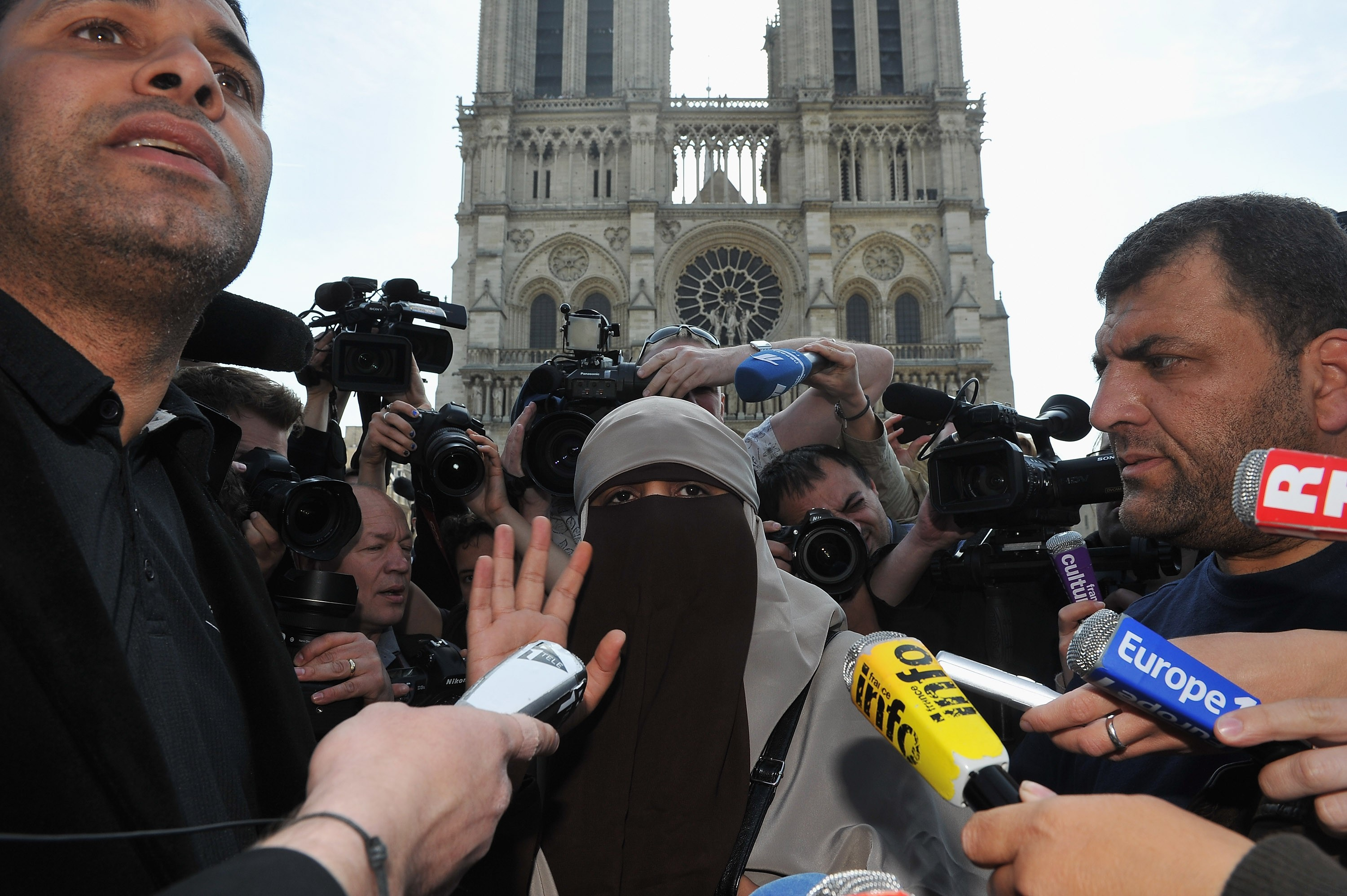 "PARIS, FRANCE - APRIL 11: Kenza Drider addresses the media as she demonstrates against the ban of the 'niqab' or full-face veil in public places, on April 11, 2011 in Paris, France. An official ban on wearing the niqab or burka came into effect in France from first thing this morning with offenders facing a fine of EUR 150. Police have stated they will be enforcing the ban 'extremely cautiously'. Police have been issued with warnings not to arrest women in the vicinity if mosques and they have also been banned from ""citizen de-veilings"". (Photo by Pascal Le Segretain/Getty Images)"