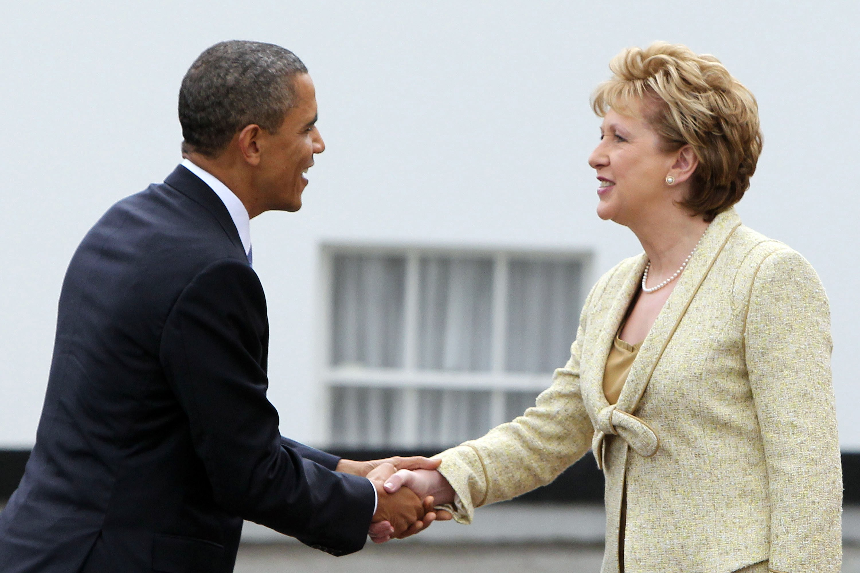 DUBLIN, IRELAND - MAY 23: U.S. President Barack Obama and Irish President Mary McAleese shake hands at Aras an Uachtarain, the official residence of the President of Ireland, May 23, 2011 in Dublin, Ireland.  Obama is visiting Ireland for one day. He will meet with distant relatives in Moneygall and speak at a rally in central Dublin after a concert.  (Photo by Irish Government - Pool /Getty Images)