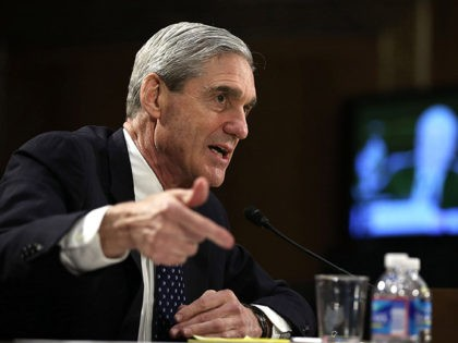 WASHINGTON, DC - JUNE 19: Federal Bureau of Investigation (FBI) Director Robert Mueller testifies during a hearing before the Senate Judiciary Committee June 19, 2013 on Capitol Hill in Washington, DC. Mueller confirmed that the FBI uses drones for domestic surveillance during the hearing on FBI oversight. (Photo by Alex …