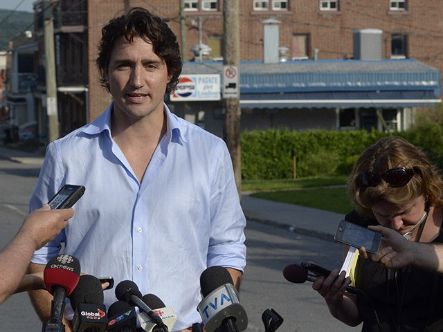 Justin Trudeau, leader of the Liberal Party of Canada, speaks during a press conference July 8, 2013 in Lac-Megantic, two days after a massive explosion caused by a runaway oil tanker train derailed and flattened part of the small Canadian town. The death toll has risen to 13, a coroner …