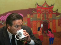 CHONGQING, CHINA - FEBRUARY 16: (CHINA OUT) Howard Schultz, president of the US Starbucks coffee chain, drinks a cup of coffee in the first Starbucks store on February 16, 2006 in Chongqing Municipality, China. Starbucks is taking the plunge into the Chongqing market. The Chinese coffee market is expected to …